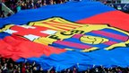 Fans hold a giant FC Barcelona flag