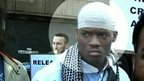 Alleged attacker Michael Adebolajo(Left, in white clothes)