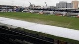 A muddy Cardiff Arms Park covered with plastic