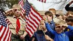 Boy scouts recite the US pledge of allegiance in front of the group's headquarters in Dallas, Texas February 2013