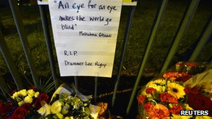 Flowers and notes have been left in memory of Drummer Rigby outside Woolwich barracks.