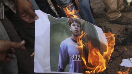 Indian cricket fans burn a picture of Indian cricketer Shanthakumaran Sreesanth at a protest during the Indian Premier League (IPL), in Ahmadabad, India, Thursday, May 16, 2013