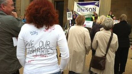 Union members and protestors outside the council