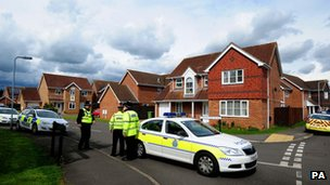 Police close a road in Saxilby, Lincolnshire leading to a house which was raided in connection with the terror attack in Woolwich