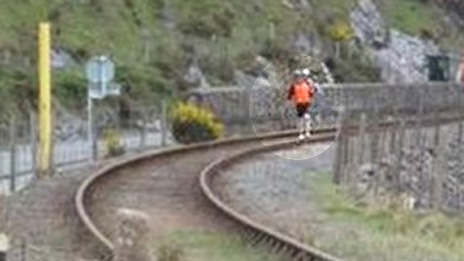 This cyclist was spotted carrying his bike along tracks