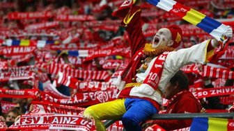 Supporters of Mainz cheer prior to the Bundesliga match between FSV Mainz 05 and VfL Wolfsburg at Coface Arena on April 20, 2012 in Mainz, Germany