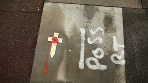 A single remembrance lies on the pavement at the scene where Drummer Lee Rigby was killed.