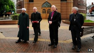 Religious leaders of different faiths at meeting at a mosque in Leicester