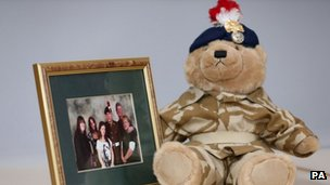 Teddy bear and family photo