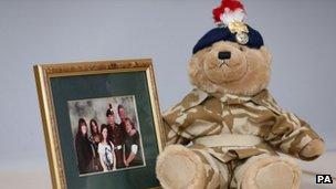 Teddy bear and family photo
