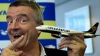 Ryanair chief executive Michael O'Leary with a model aircraft