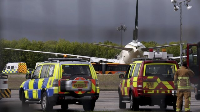Police and rescue service vehicles, Friday, May 24, 2013, at Stansted Airport