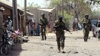 Nigerian troops patrol northeast town of Baga on 30 April 2013.
