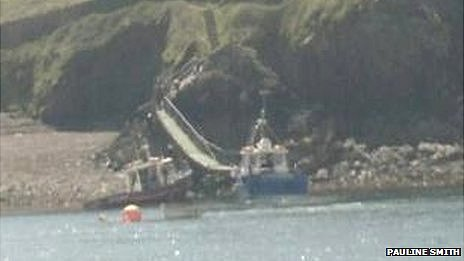 48 rescued as island boat hits rock...