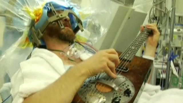 VIDEO: Man plays guitar during brain surgery...