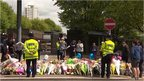 Flowers continue to be laid at the scene of the attack and outside the barracks