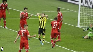Dortmund's Jakub Blaszczykowski shows his frustration after his shot is saved