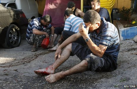 Injured men were treated by friends after the rocket attack