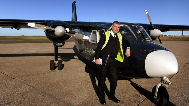 Stuart Linklater with his Islander eight-seater plane