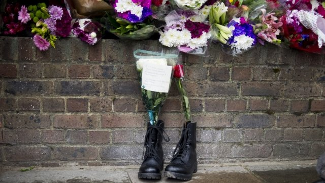 Combat boots containing floral tributes to Drummer Lee Rigby