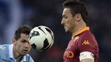 Roma forward Francesco Totti (centre) vies with Lazio's defender of Bosnia Senad Lilic (left) and Romanian defender Stefan Radu