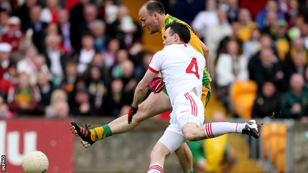 Colm McFadden holds off Cathal McCarron to score Donegal's first-half goal