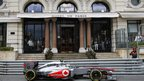 Sergio Perez drives past the Hotel De Paris in Monte Carlo