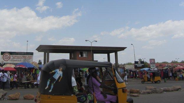 Women in a tuk-tuk taxi in Yola Adamawa state, Nigeria