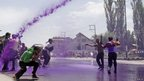 Coloured water is fired on Kashmiri government employees protesting in Srinagar, Indian-administered Kashmir, on 27 May.