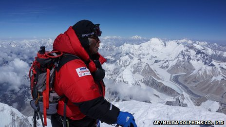 80-year-old Japanese man Yuichiro Miura stands atop the summit of Mount Everest (23 May 2013).