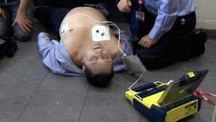 Employees during a training exercise on how to use an automatic electronic defibrillator (AED)