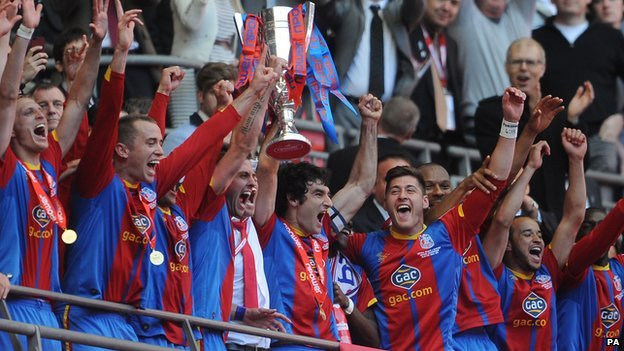 Crystal Palace players lift the trophy after being promoted to the Premier League.