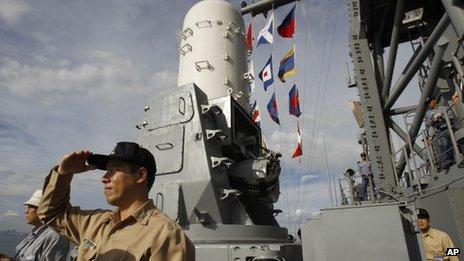 Commander Huang I-che watches ships from the deck of a Taiwanese Kidd-class destroyer during exercises off of the southern city of Kaohsiung, Taiwan on 15 May 2013