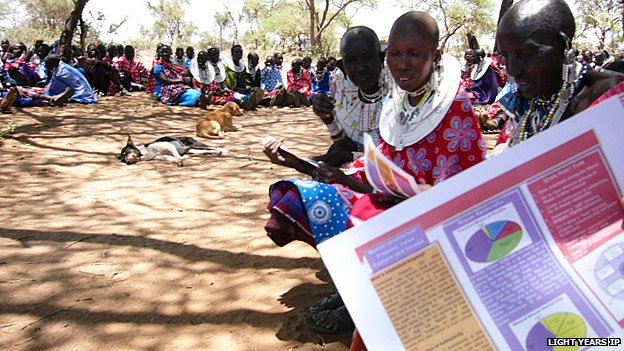 A large group of Maasai women learning about intellectual property