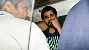 Indian cricketer Shanthakumaran Sreesanth sits in a police vehicle on his way to court in New Delhi on May 28, 2013.