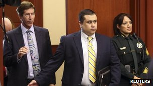 George Zimmerman arrives in court for a pre-trial hearing with his lawyer in Sanford, Florida 28 May 2013