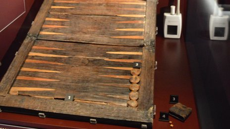 Backgammon set and dice shaker and two dice found in the carpenter's cabin