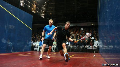 Peter Barker of England plays Tom Richards of England (l) during their quarter-final match in the Canary Wharf Squash Classic on March 20, 2013 in London