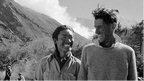 Edmund Hillary and Tenzing Norgay smile at each other on the descent after climbing Mount Everest