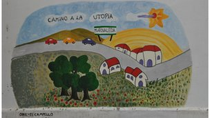 "A mural in Marinaleda depicts cars on the ""way to utopia"""