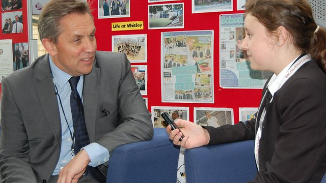 Sainsbury's chief executive Justin King talks to a school pupil