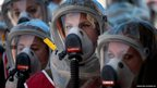 Israelis wearing protective gear participate in a drill at a Hospital in Jerusalem