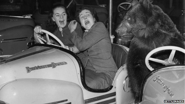 Two ladies in a bumper car at Olympia in 1954 get a shock