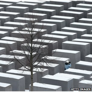 A visitor walks through the Memorial to the Murdered Jews of Europe in Berlin, Germany