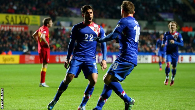 Croatia players celebrate scoring against Wales in a World Cup qualifier