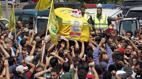 Lebanese mourners carry the coffin of Hezbollah fighter Saleh Sabagh, 18, who was killed in a battle against Syrian rebels in the Syrian town of Qusair