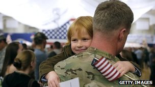 Child hugs Master Sergeant Adam Shaw