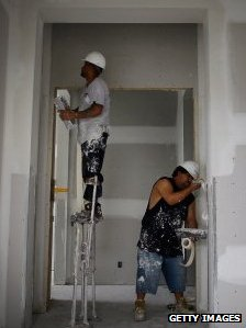 Men help to build a house