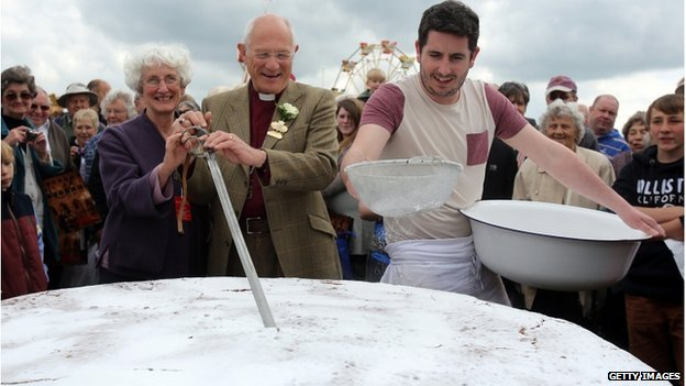 Huge Victoria sponge cut by the Bishop of Bath and Wells, the Right Reverend Peter Price, Royal Bath and West Show May 2013