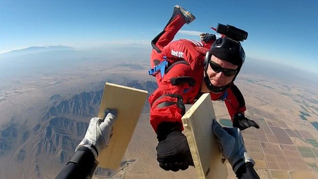 Ernie Torres doing a karate move whilst skydiving